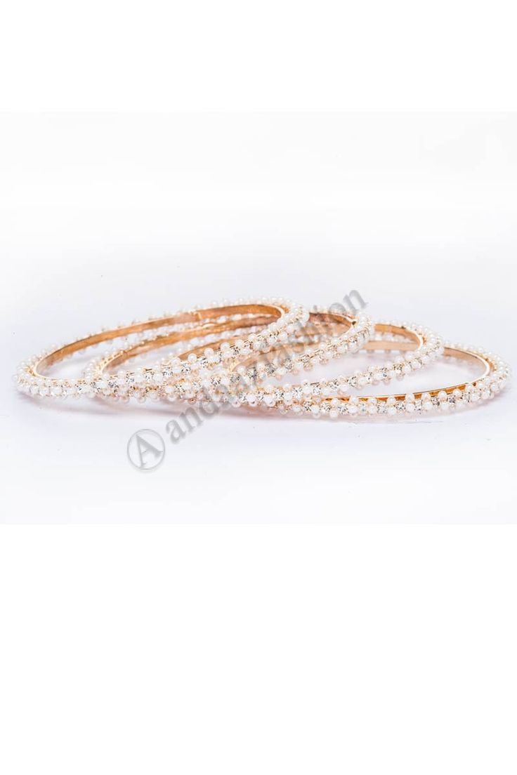 Crystal & Pearl bangle set Design No. 80408 Price:- £6.00 Crystal & Pearl studded 4 piece bangle set. For More Details:- http://www.andaazfashion.co.uk/jewellery/bangles/crystal-pearl-studded-4-piece-bangle-set-80408.html