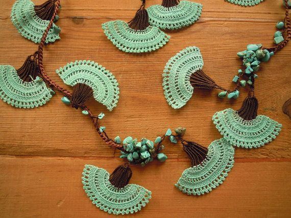 Lariat necklace made brown thread and turquoise chip beads. The large crochet carnatlons  are made with turquoise and brown thread.    Length: about