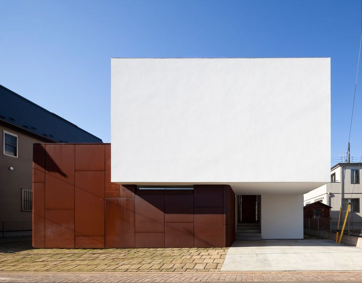 Corten steel and render composition of main facade