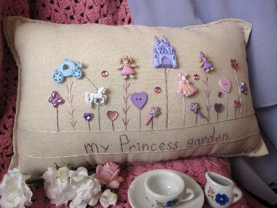 This princess-themed hand-made muslin needlework pillow is perfect for that sweet little princess in your life! Size is approximately 16 x 8.