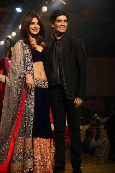 Manish malhotra with priyanka chopra.   Indian woman fashion.