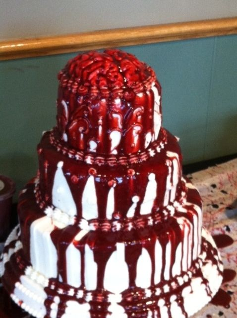 Halloween Wedding Cake - This Halloween Wedding cake is a 3 tier red velvet with  buttercream icing, fondant brain, and strawberry/cocoa syrup blood.