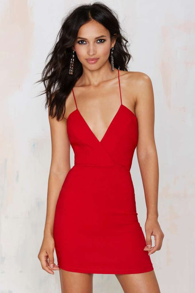 Your ego boost now comes in fabric form.The Billie Dress is cherry red and features plunging neckline, crossover bodice, and strap design at back.