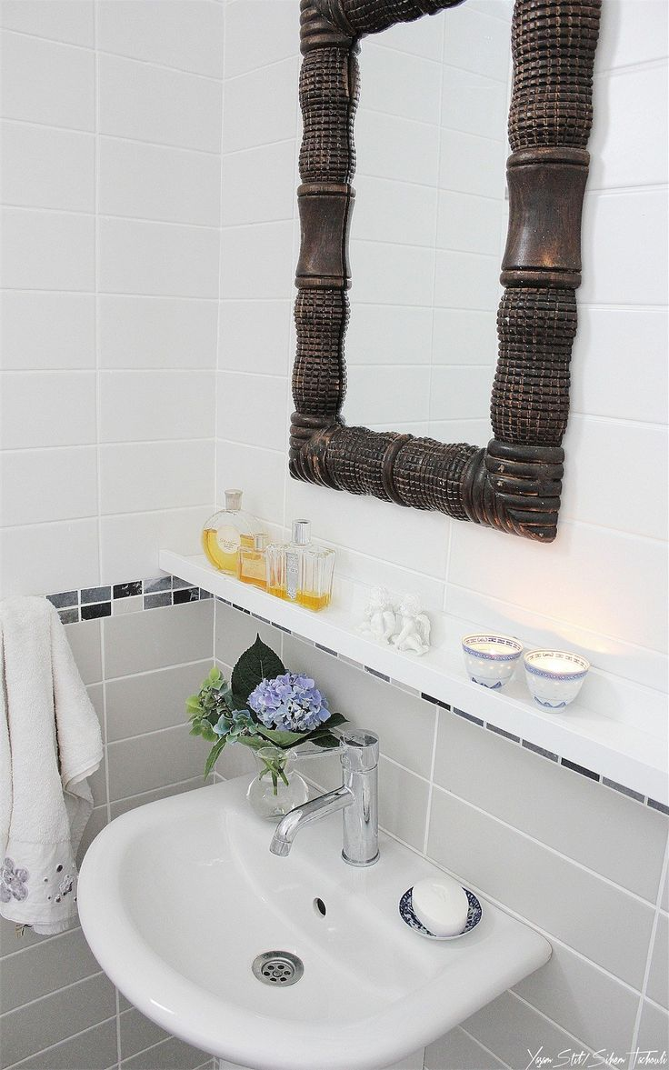 Ikea hack - Ribba picture ledge used in the bathroom