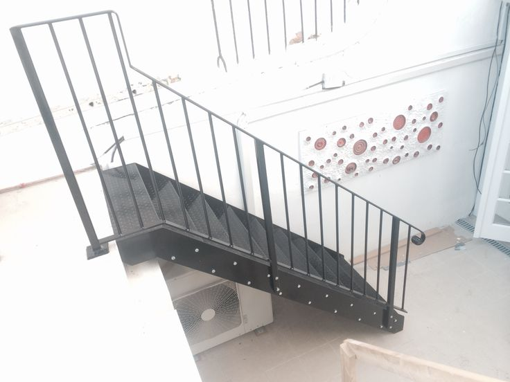 RSG4600 fabricated staircase with handrails, professionally fitted to a residential project in Kensington.