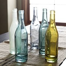 I started saving wine bottles at home, and running the labels under super hot water to make them clear - So cute hidden around the house!