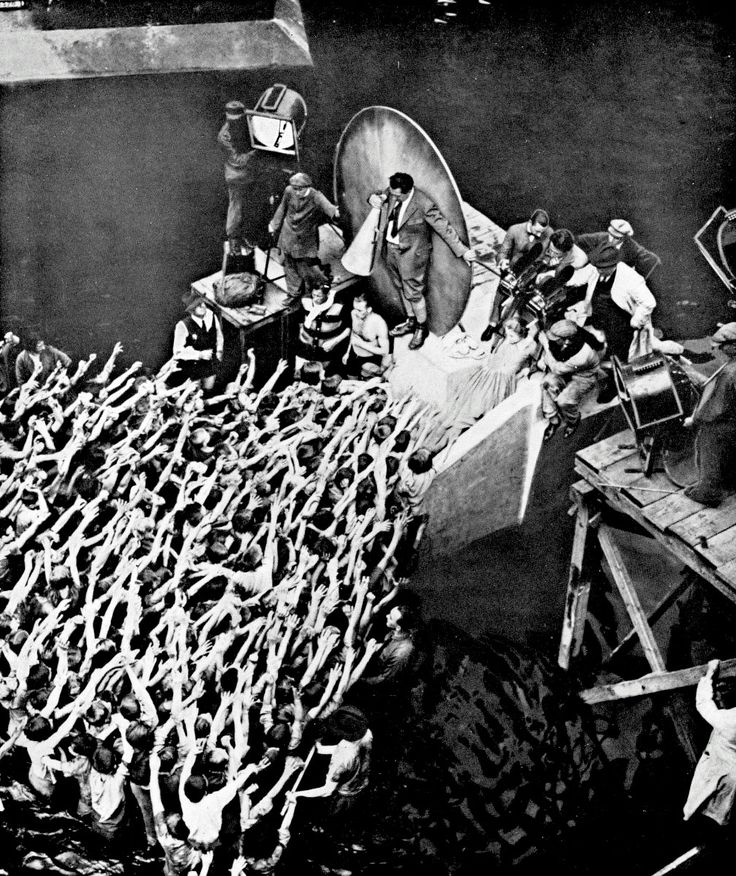 Fritz Lang directing the crowd on the set of Metropolis, 1925