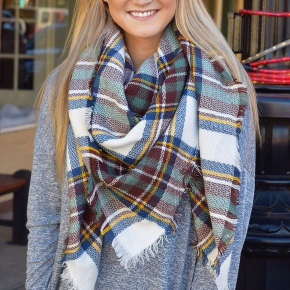 NWT Teal Brown Tartan Blanket Scarf Square Large This large blanket scarf is one of the most popular items of the season! There are many ways to wear this staple piece, so the options are endless! It's great for the cold weather, so get it now before the harshest part of the winter hits! Also available in other colors, so check out my closet! Paperback Boutique Accessories Scarves & Wraps