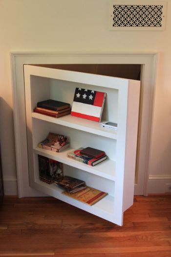 Built-in, hinged bookcase for crawl space access area in basement instead of a door