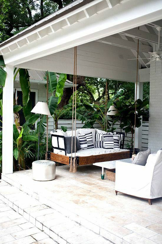 Hanging swing on a beach front porch....
