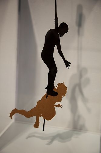 Kara Walker - use of silhouette creates a shadow that makes it come alive