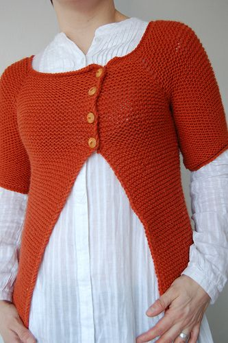 A simple asymmetrical top-down raglan cardigan, worked in squishy garter stitch. Perfect for keeping warm at the office, or throwing on over a dress…if you like that sort of thing. Personally, I'm allergic to dresses. :)