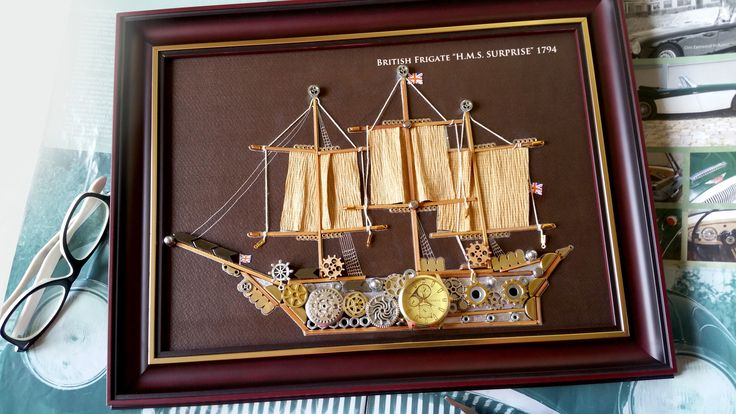 """Description ♥ Nautical Steampunk Art, British frigate 1794 made from old clock parts and metal components, unique model, similar to the model already established.♥  ♥ Wood frame, very elegant, exterior size 32 cm x 41 cm, ( 12.59"""" x 16.14"""" ) is perfect for a gift addressed especially to collectors.♥"""