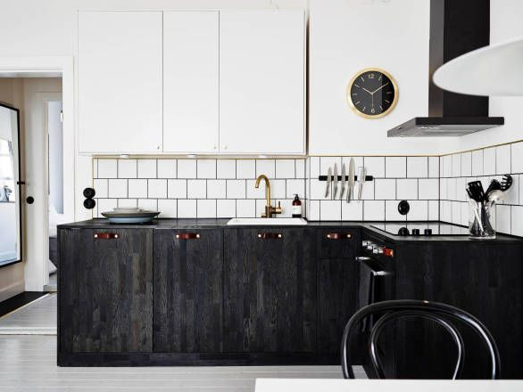 Black and white industrial kitchen by ApartmentStudios