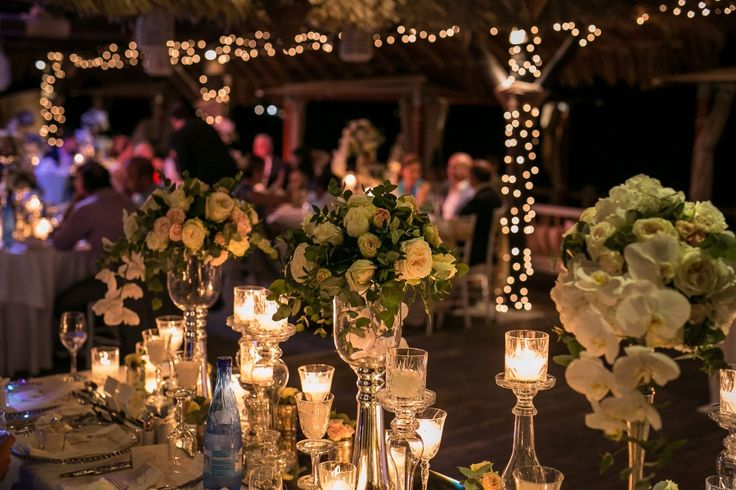 High flower compositions  with garden roses, white orchids and crystal candelabras make up  this elegant art de la table!
