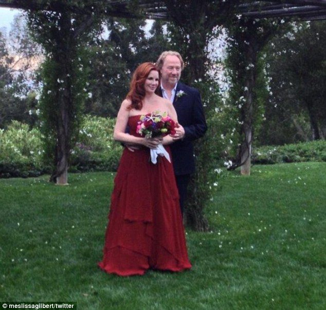 And the bride wore red! Little House On The Prairie star Melissa Gilbert slips into a scarlet gown to wed actor Timothy Busfield in Santa Barbara on April 24, 2013.