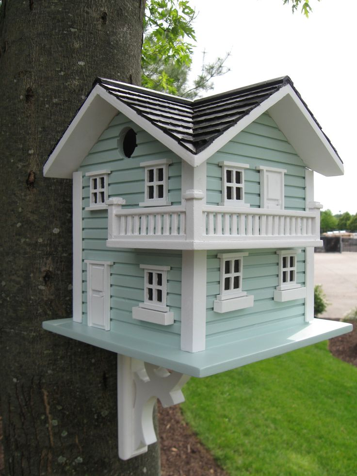 This birdhouse comes to you straight from Long Beach Island on the Jersey Shore. This two-story house has a wraparound balcony on the 2nd floor and plenty of windows for all of the nesting occupants.