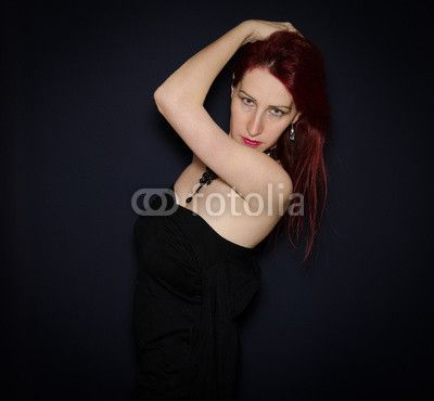 Gothic woman in black dress. #Gothic #Goth #Isolated# RedHair #Fashion #Model #caucasian #Beauty #Makeup #Black #Dark #Cosmetics #Style #Glamour #BlueEyes #Expression #Portrait #StudioShot #Background