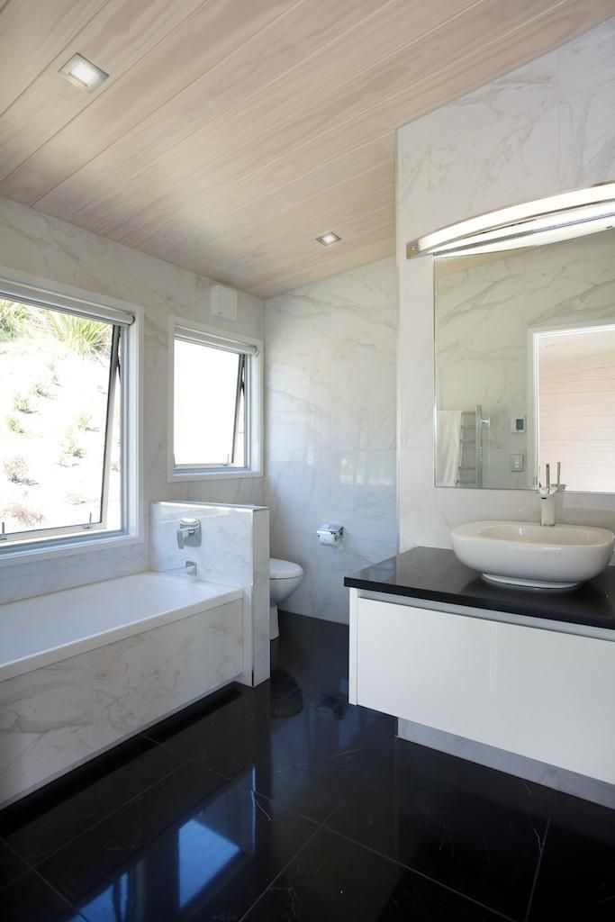Gorgeous white and black marble styled main bathroom