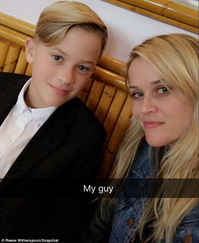 'My guy': Later, the mother-daughter duo headed to The Ivy for lunch, where they were joined by their family. Reese is pictured with son Deacon Phillippe, 13