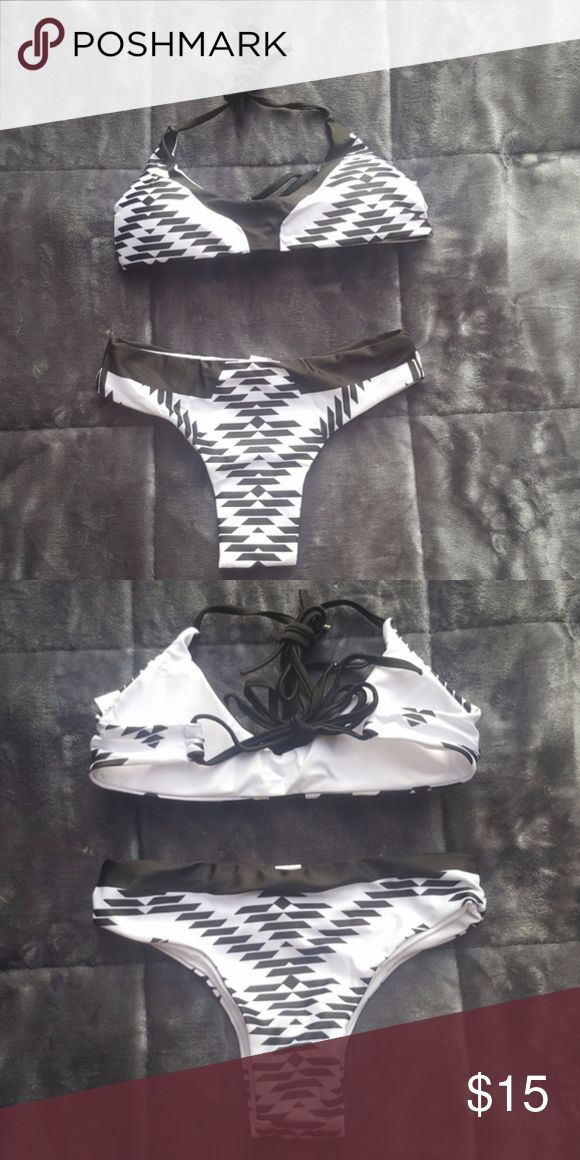 Super Cute Black and White Bikini Brand New super cute black and white bikini set! Show of your figure in this suit at the beach or pool!! **Size small but does run small Swim Bikinis