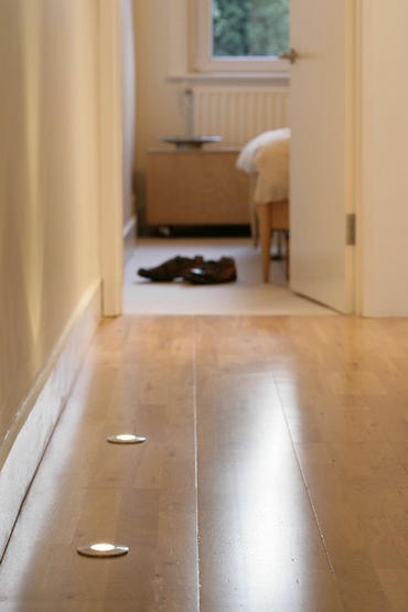 Recess small lights (like the ones you install under upper cabinets in the kitchen) into the floor of a dark hallway - better than turning on a super bright overhead light to find the way to the bathroom at night!