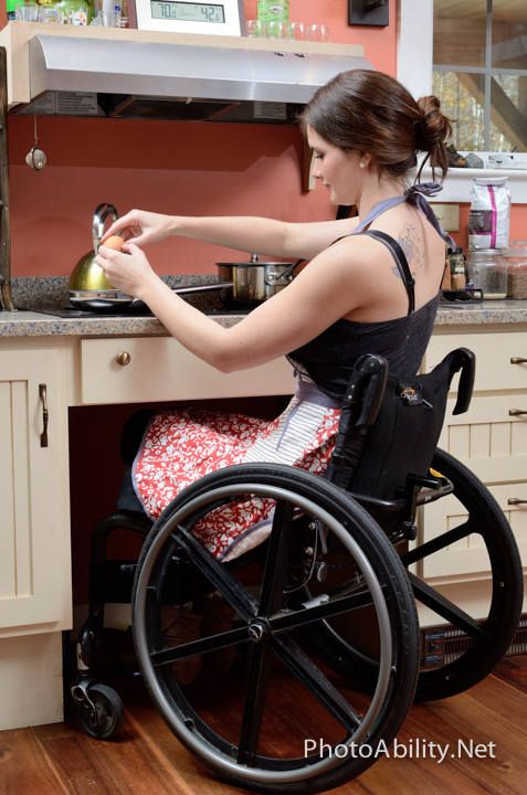 Young woman using a #wheelchair cooking in her adapted kitchen. Model Bridget L. by Tom Kershaw for PhotoAbility.net