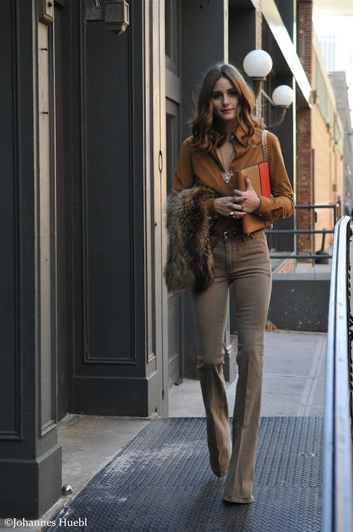 Olivia Palermo, in a Theory blouse, Reiss Pants, Carrara y Carrara Jewelry, Adrienne Landau Fur Stole, Chanel Bag, and Jonathan Saunders for Smythson iPad Case 47 12
