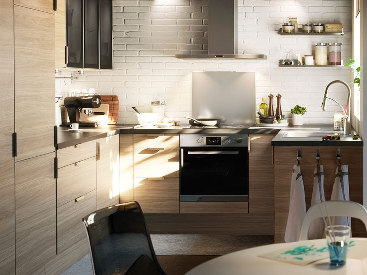 A tiny kitchen made for a family    Get all the room you need in a tiny kitchen with inserts, handy storage for cookware and tableware and a smart space-saving solution for storing the vacuum cleaner.