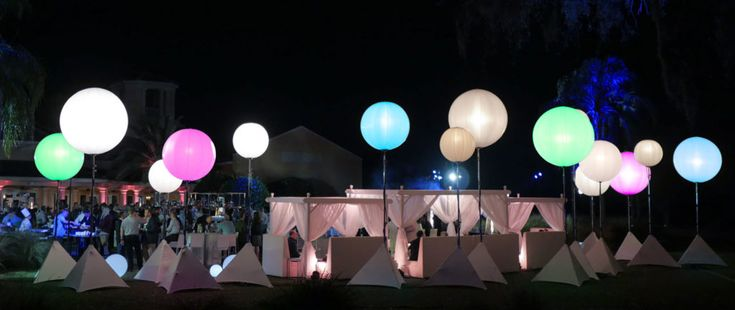 Colourful balloon lighting for an outdoor, back yard reception.