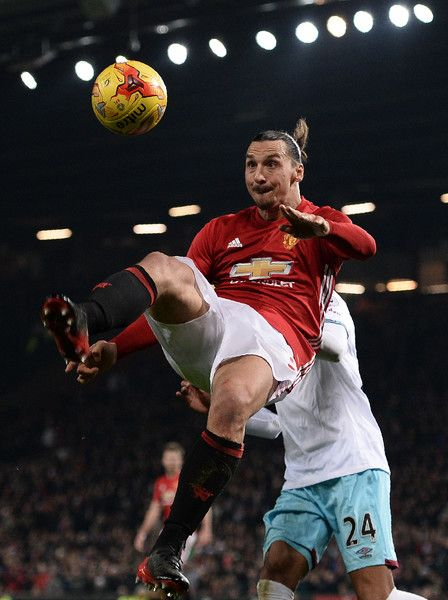 Manchester United's Swedish striker Zlatan Ibrahimovic jumps to cross the ball during the EFL (English Football League) Cup quarter-final football match between Manchester United and West Ham United at Old Trafford in Manchester, north west England, on November 30, 2016. / AFP / Oli SCARFF / RESTRICTED TO EDITORIAL USE. No use with unauthorized audio, video, data, fixture lists, club/league logos or 'live' services. Online in-match use limited to 75 images, no video emulation. No use in…