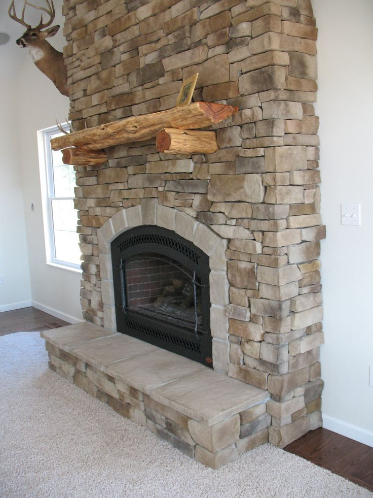 Stone fireplaces bing images for the home pinterest for Faux marble fireplace mantels