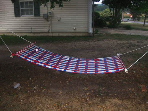 DIY duct tape hammock. Heck yeah! I would make this in pretty tropical colors like green, blue, and yellow, and I would make a detacheable cover/pad for it using the rag rug weaving tutorial so it was super comfortable.