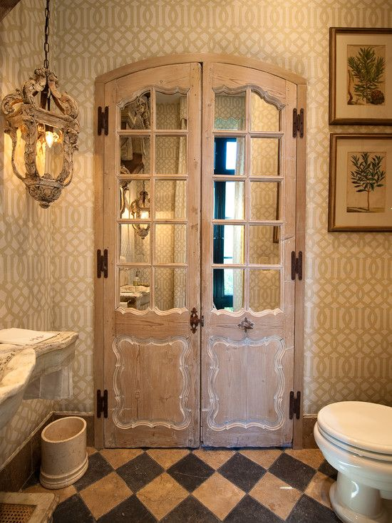 ♥ this look! Old doors with mirrors added behind the panes add a great look in this bathroom..are they entry doors or do they reveal a linen closet?...hmm