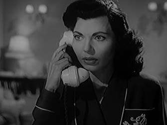 0 Simone Silva on the phone in escape by night 1953