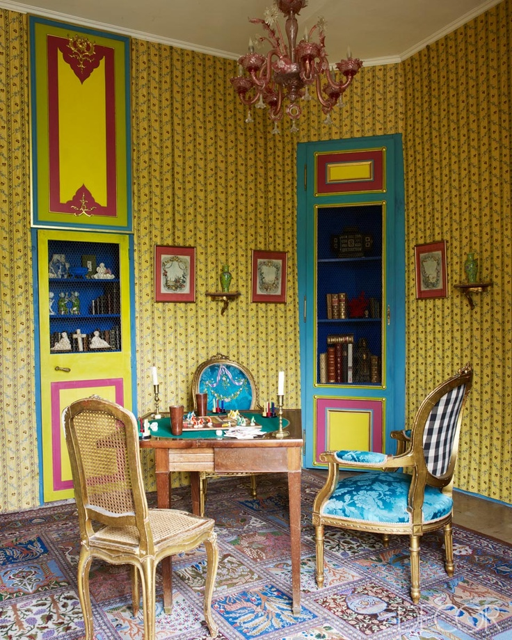colorful yellow and blue eccentric games room covered in antique furnishings