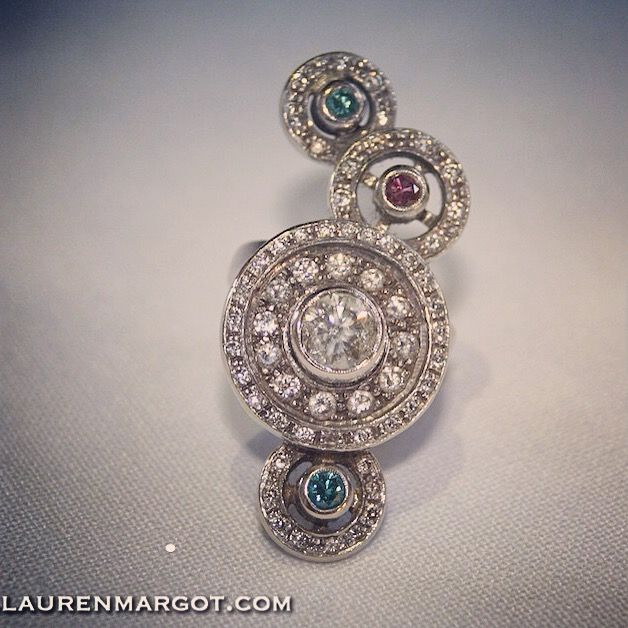 This magnificent ring is made from 18ct White Gold, Blue, Pink & White Diamonds.