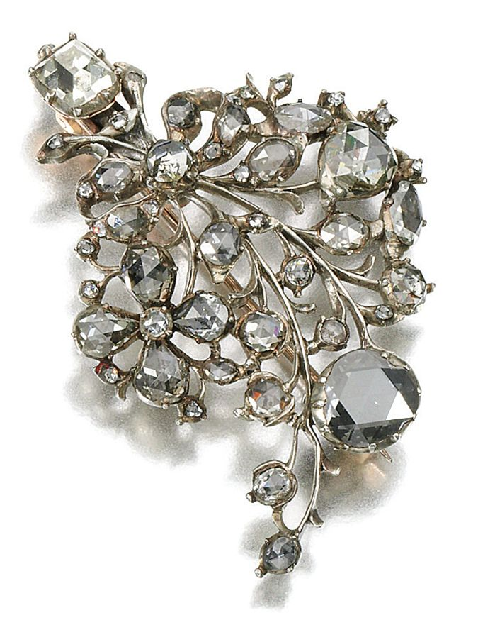 DIAMOND BROOCH, LATE 18TH CENTURY, COMPOSITE.  Of spray design, set with rose and table-cut diamonds, later brooch fitting.