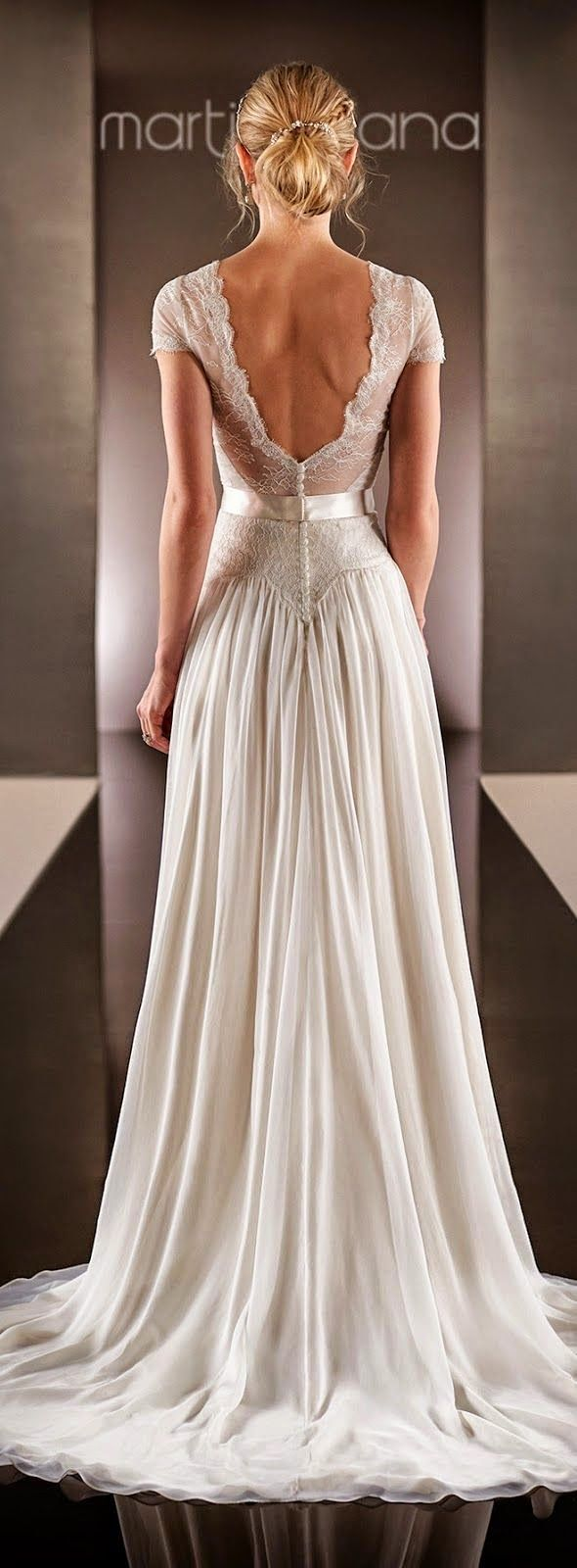 Martina Liana 2015 wedding dress is a must have with the floor lenght modern aline effect with small details and low back it is perfect for every bride