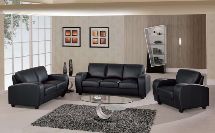 room living room with black leather sofa and glass table above grey
