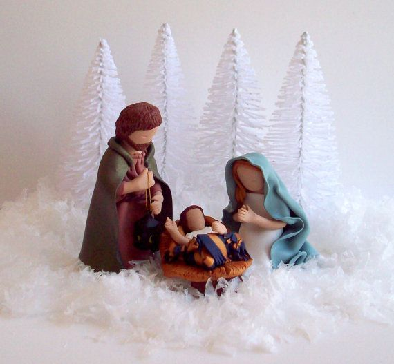 The white elements make a beautiful display for a colorful nativity. (The nativity is made by an artist on Etsy -- no longer available). #nativity