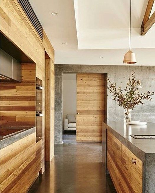Cooper hanging in a very dreamy timber kitchen by Altereco Design. Photo: Nikole Ramsay. Styling: Emma Omeara