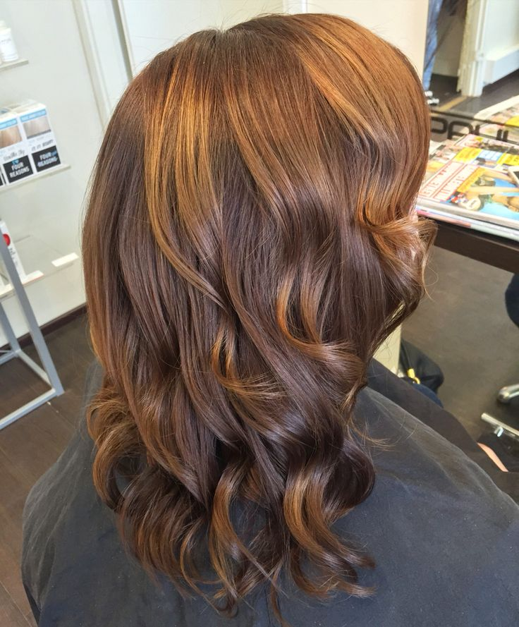 Red hair waves made by Ghd Curve