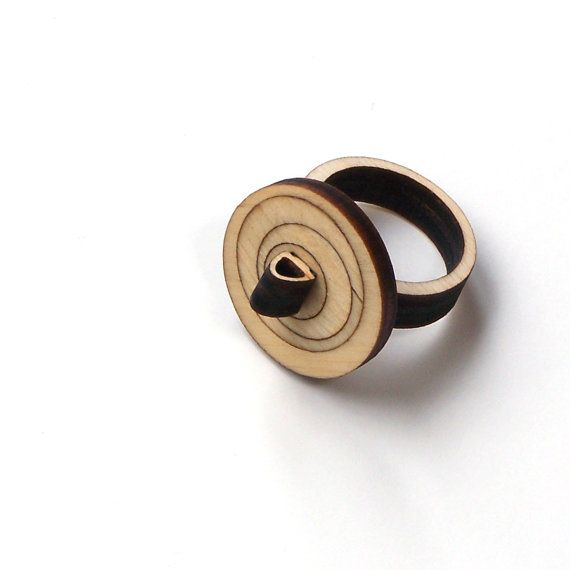 Laser cut, elegant wooden jewelry by ardeola - 20USD - http://www.ardeola.hu/index.php/products-menu?view=project&id=19:wooden-ring-model-2