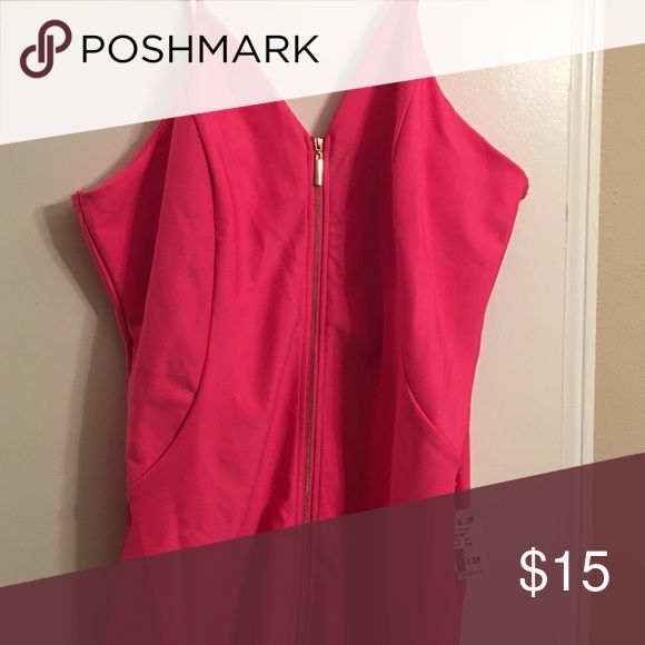 Hot Pink Junior Plus Size Bodycon Dress Tight fitting dress > Spaghetti Straps > Zips all the way in the front > Polyester lining > Shell: 95% Polyester 5% Spandex > Hits a little at the knee and I'm 5'6 Dresses Midi
