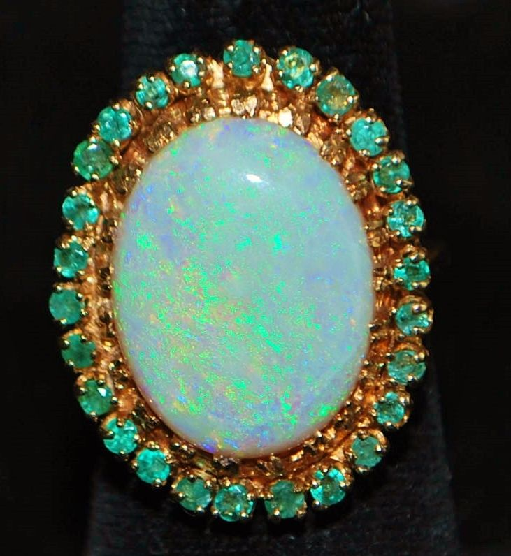 Elegant and Opulent 14K Yellow Gold, 9Ct. Oval Opal and Emerald  Ring, 1970's.