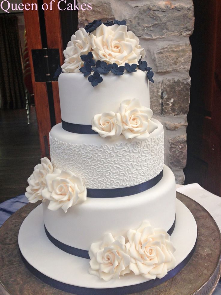 Cornelli lace wedding cake with Ivory sugar roses and navy hydrangeas, by Queen of  Cakes
