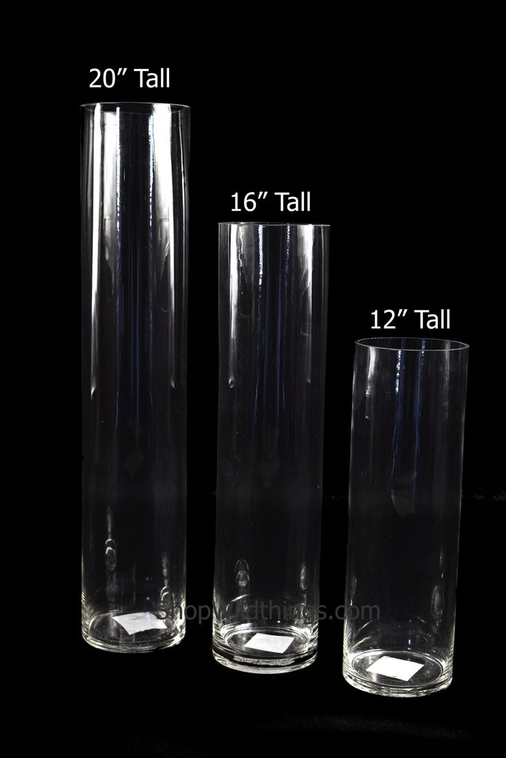 """Our tall cylindrical glass vase is perfect for a centerpiece either by itself or being the focal point for a larger centerpiece.  This clear glass vase is 20"""" tall and just under 4"""" in diameter and the"""