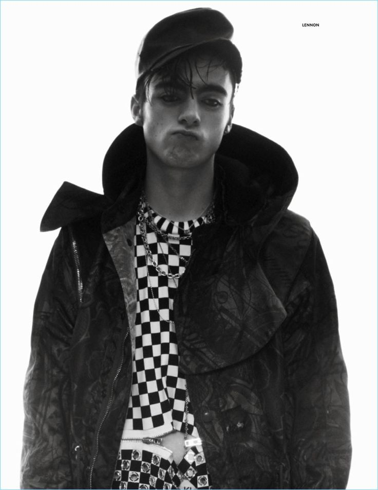 Pouring on the charm, Lennon Gallagher wears a Givenchy jacket and zippered top with a vintage leather cap from Costume Studio.