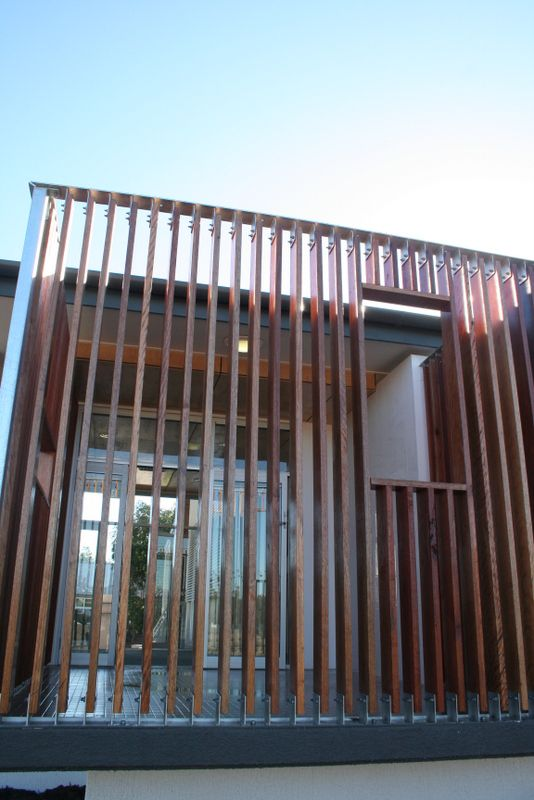 timber batten screen with opening